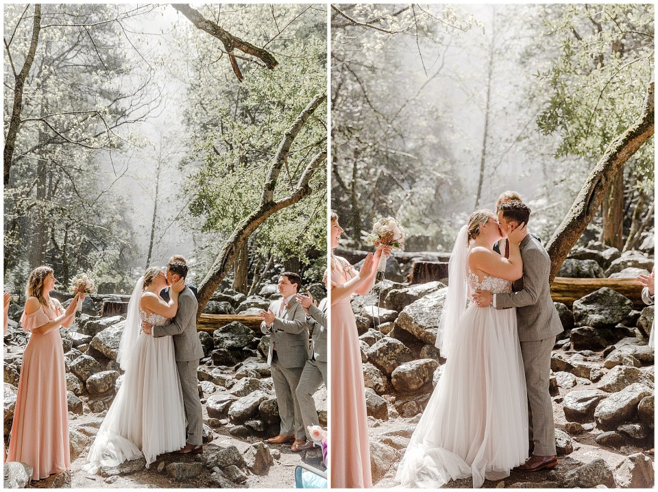 bride and groom do first kiss at bridal veil falls in yosemite