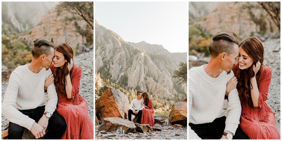 couple sits on a rock with a beautiful mountain view behind them on their Big Cottonwood Canyon Engagement Session