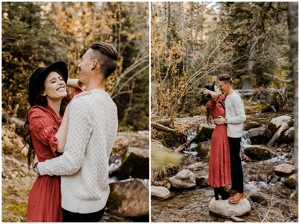 man hugs his fiance as they balance on a rock during their Big Cottonwoon Canyon Engagement Session