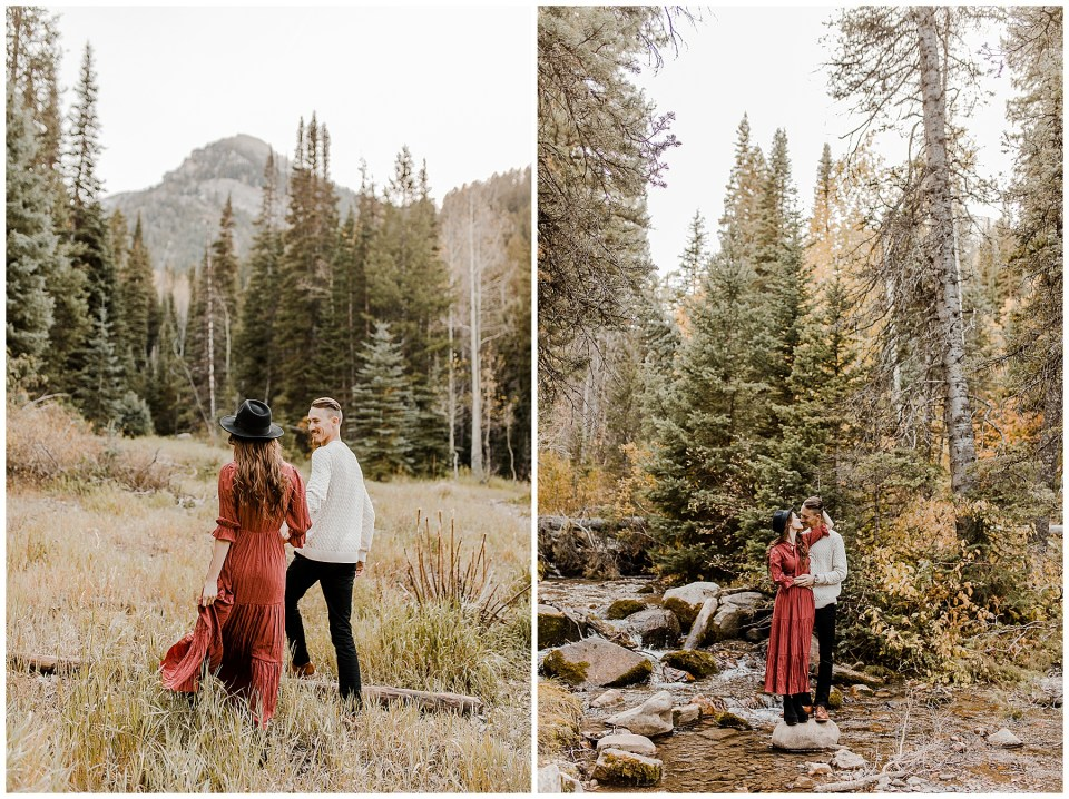 Couple holding hands and kissing in the forrest during their Big Cottonwood Canyon Engagement Session