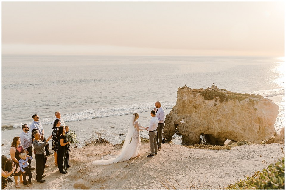 man and woman say their vows on a cliff by the ocean during their El Matador Beach Elopement
