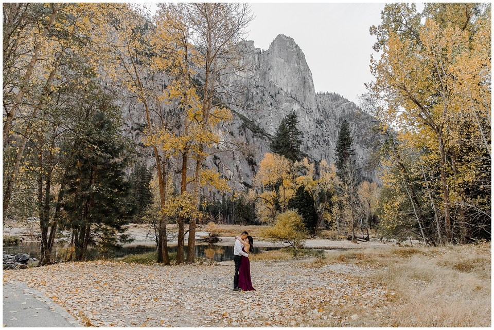 bride and groom enjoying sunrise with fall colors during their adventurous yosemite engagement session