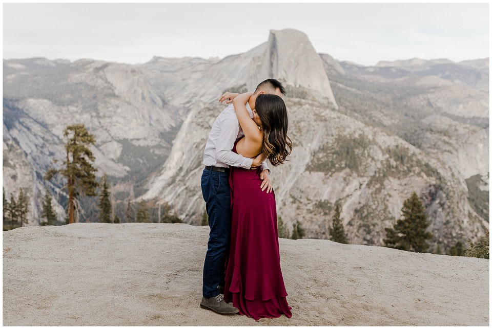 bride and groom take glacier point engagement photos