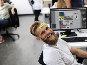 man laughing beard office working people