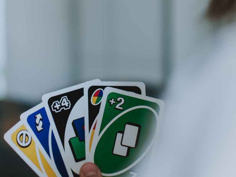 person holding uno cards