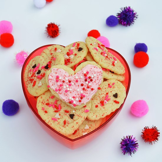 Soft and chewy gluten free sugar cookies that can be shaped and decorated with sprinkles just like those complimentary grocery store sugar cookies.