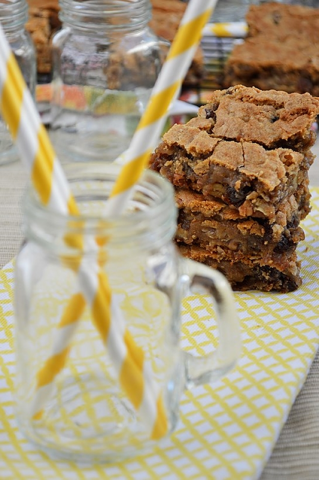 Soft and chewy Gluten Free Oatmeal Raisin Cookie Bars with a mixture of old fashioned rolled oats, plump raisins, and chopped pecans.