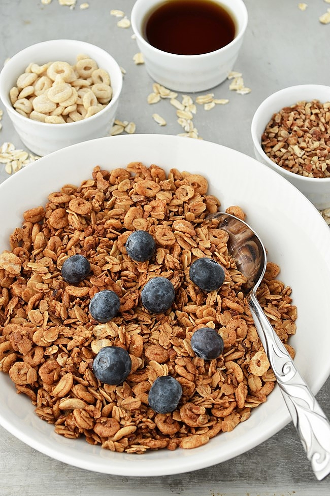This Gluten Free Maple Pecan Granola is the perfect combination of oats, toasted oat cereal, pecans, coconut, and banana chips. All tossed in a maple cinnamon coating.