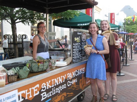 Jennie and Emma showing off their crepes from The Skinny Pancake!
