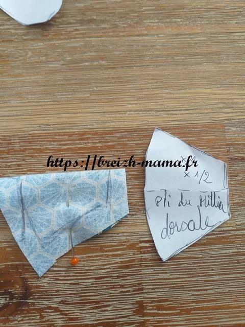 8 - Plier le tissu de la nageoire dorsale