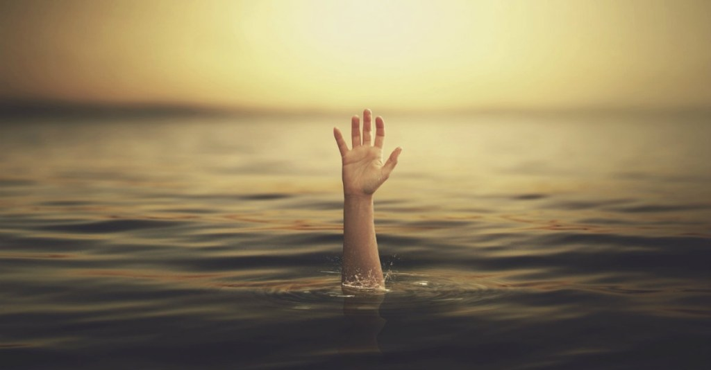 24781-hand-water-drowning-ocean-sky-death-wide.1200w.tn