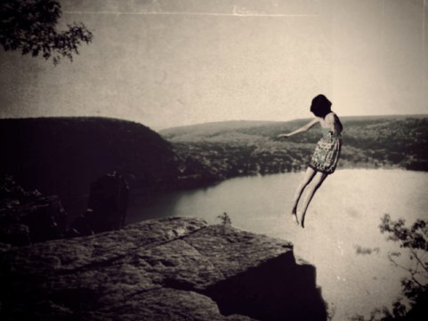 leaping off cliff woman