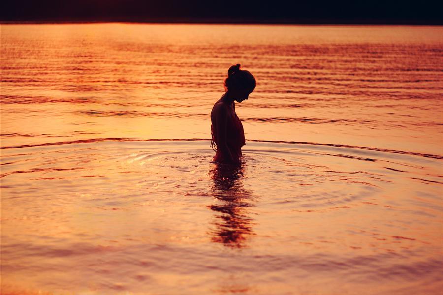woman alone in lake