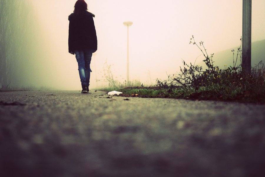woman walking away