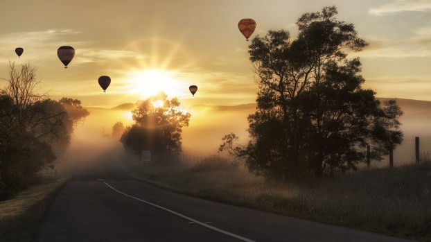 hot air balloons misty road