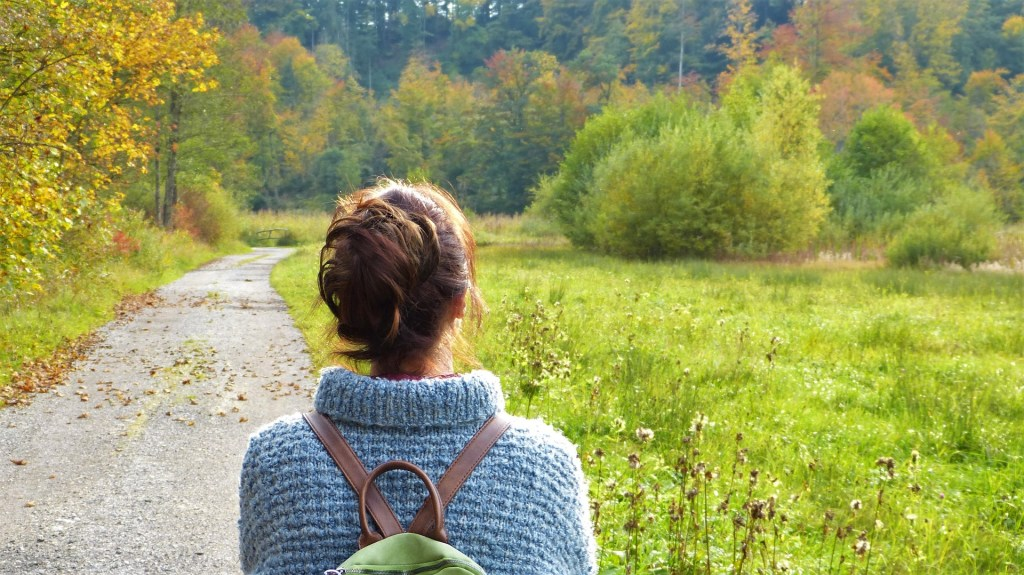 woman fall alone in woods