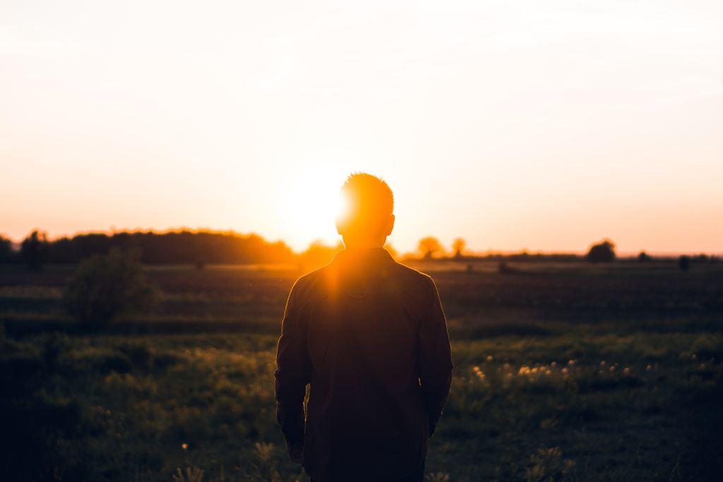 teen boy sunset