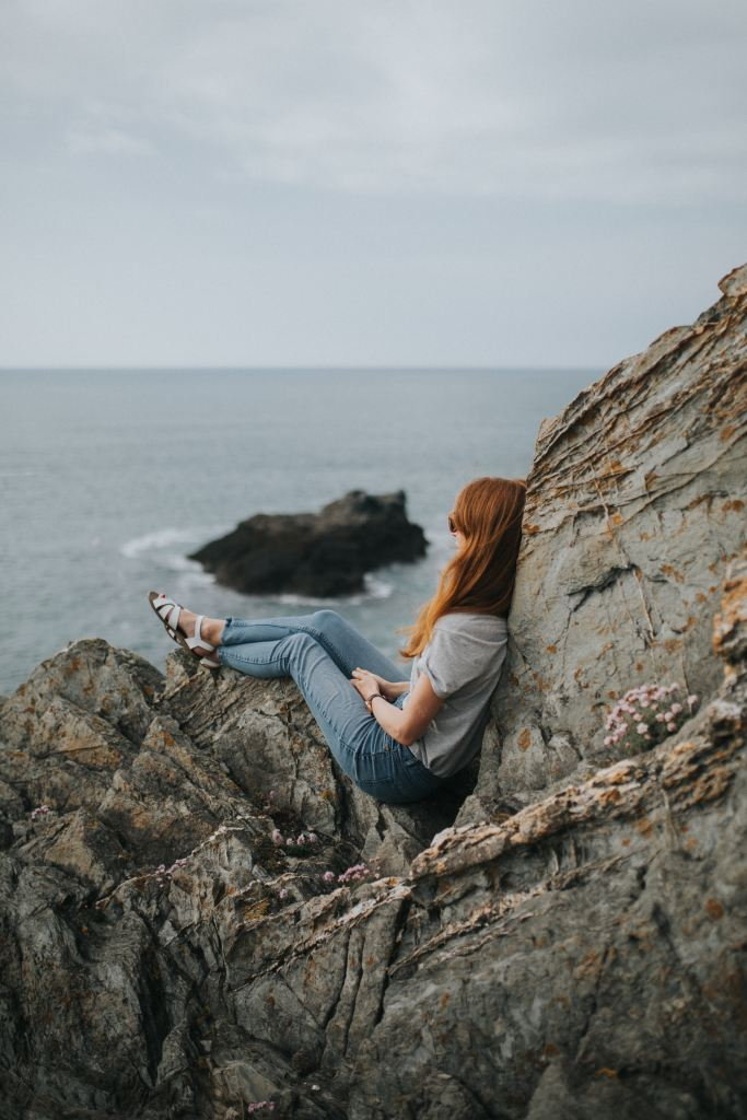 woman alone on rocks