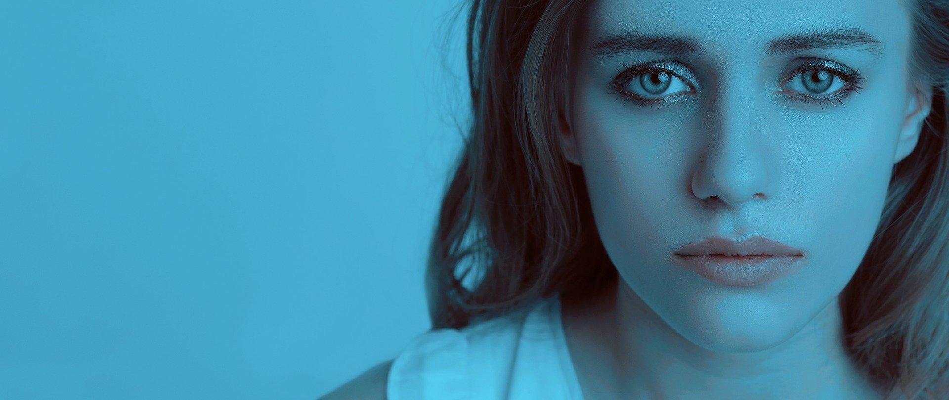 woman pensive blue