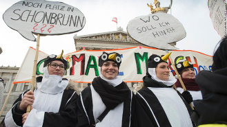 Climate change protestors in penguin suits. (2015)