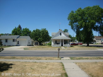 Looking west across Ash Street South, Sauk Centre; in mid-June. (June 14, 2021)