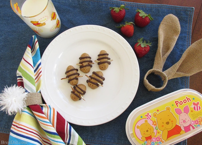 Host a family movie night with Winnie the Pooh and the rest of the gang from the Hundred Acre Woods. Easy party featured Healthy Honey Bee No Bake Cookies, free printable Winnie the Pooh treat boxes, free printable Hundred Acre Wood's Easter mazes and free printable Winnie the Pooh invitations. Get all the details at BrenDid.com