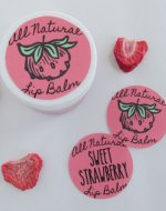 DIY Sweet Strawberry Lip Balm recipe uses simple, all-natural ingredients including real strawberries to make a lightly tinted and flavored lip gloss. Free printable label. Must try!