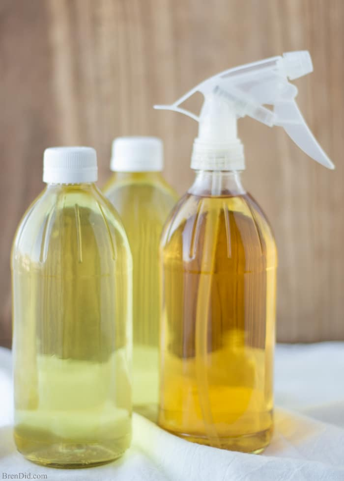 How to Make Scented Vinegar for Cleaning- This DIY cleaner made with citrus peels and herbs is easy to make and non-toxic. It cuts through grease with ease. Combines the cleaning power of vinegar and citrus oil. If you love using vinegar for green cleaning but want to make it smell better, try this! All-natural, non-toxic cleaning. No essential oils.