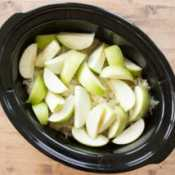 """This easy recipe combines apples, pork roast and sauerkraut in the crock pot for a tasty dinner that takes just minutes to prepare. My family loves it for the tasty combination of flavors, I love it because it is a simple """"throw and go"""" recipe for the slow cooker."""