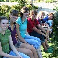 Melissa, Ashley, Heather, Mckenzie, Jamison, and Todd sit on a bridge on Skyline Trail