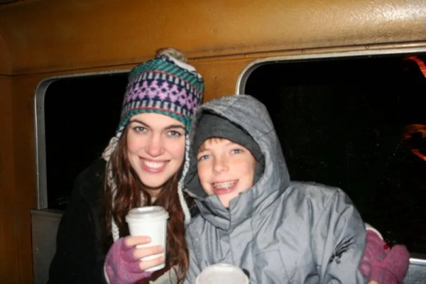Heather and Jamison enjoy their hot drinks in the train