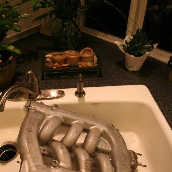 Cleaning the intake manifold in the kitchen sink. My wife is very understanding.