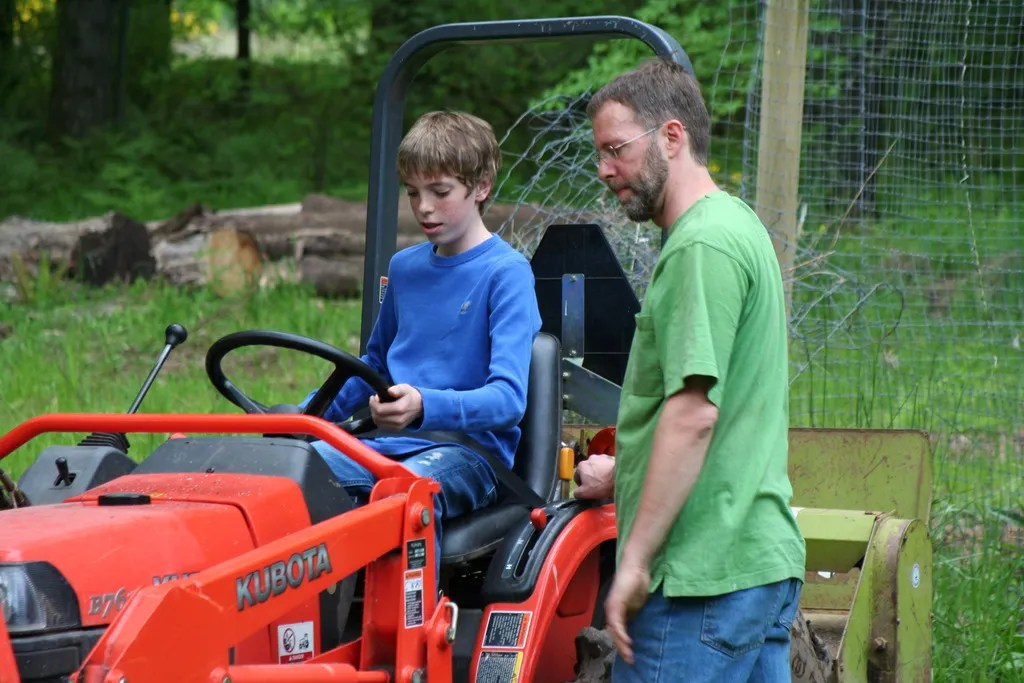 Jamison getting instruction on the tractor