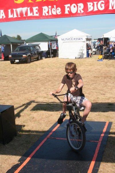 Jamison attempting to ride a backward-steering bike