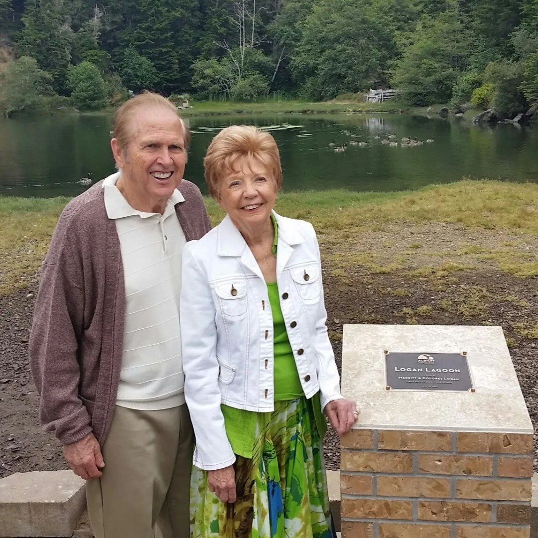 Mom and dad by newly named Logan Lagoon