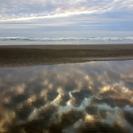 Clouds reflected at Cannon Beach