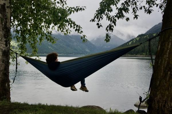 Jamison holding down a hammock at Wallowa Lake