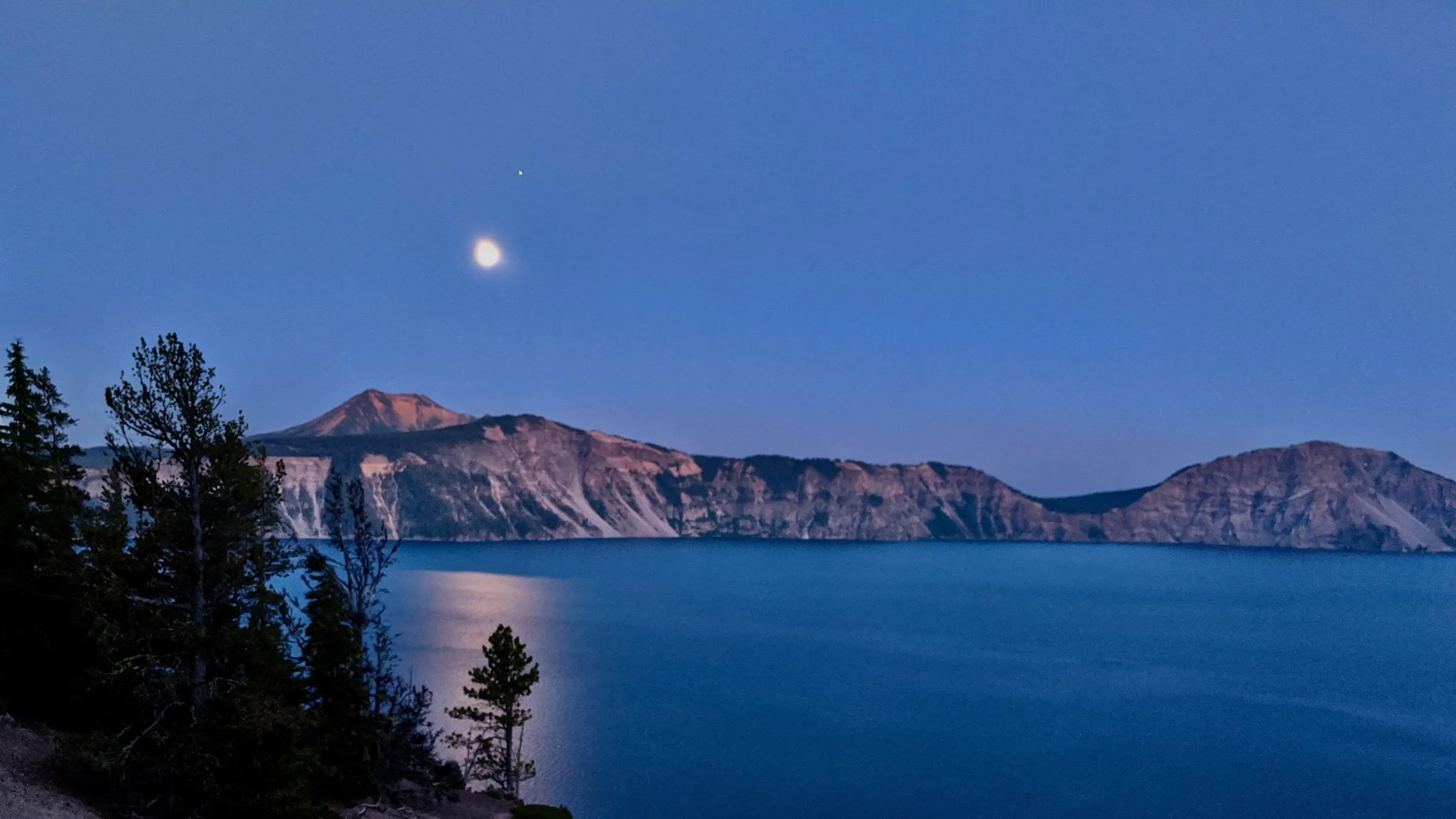 The moon rising over the east rim of Crater Lake