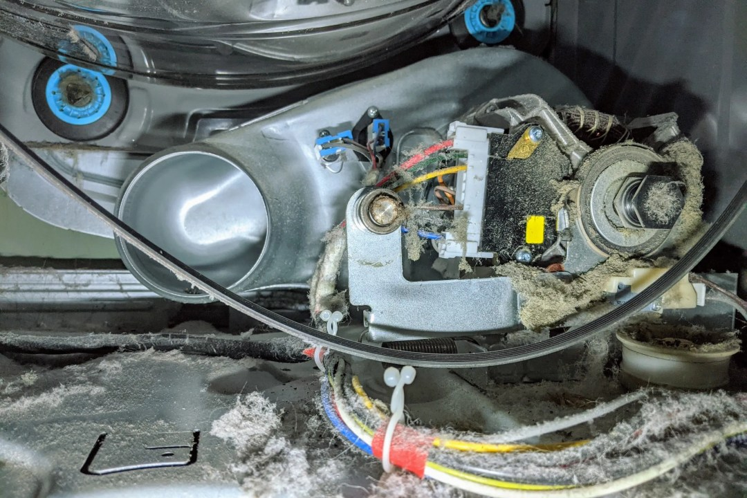 A missing idler pulley hiding in the dust bunnies