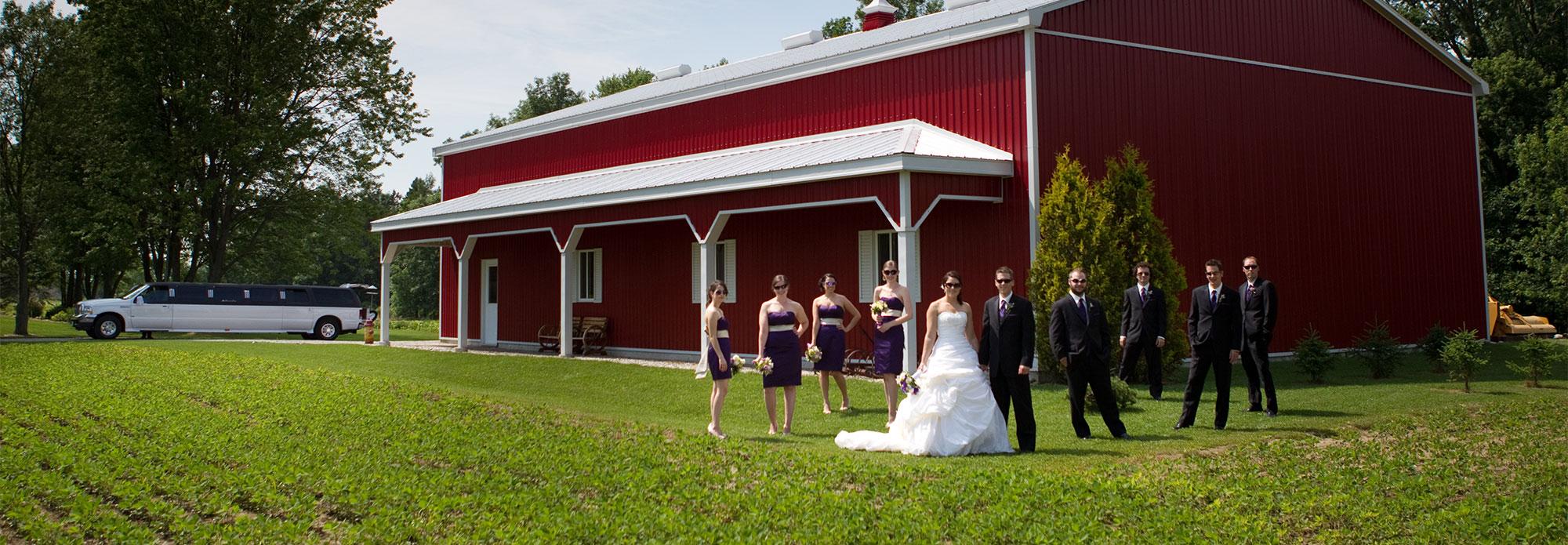 Wedding limbusine and red barn