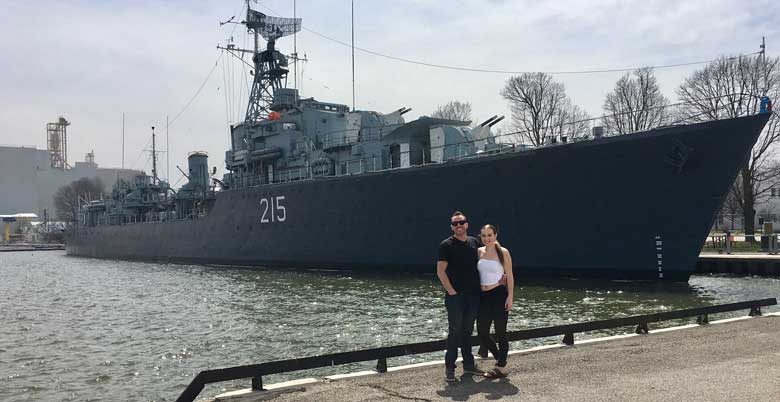 Maddy and Brent in front of the H.M.C.S Haida