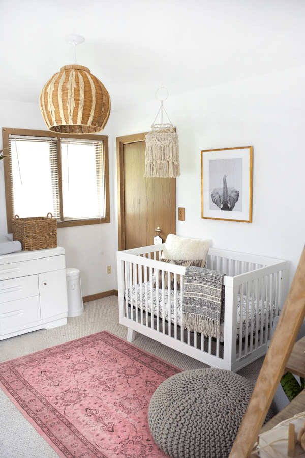 boho chic girl's nursery with pink, white and wood accents