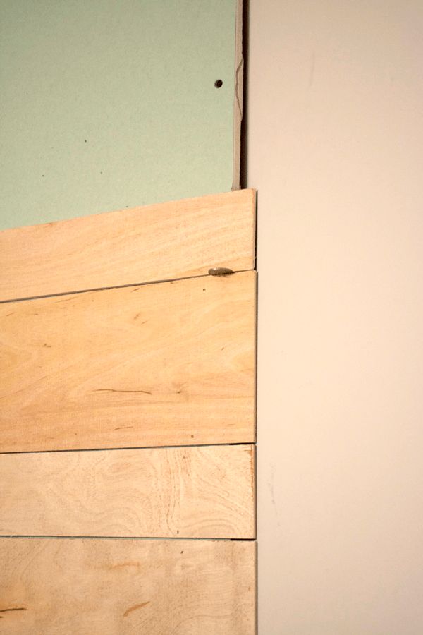 use a coin as a spacer when hanging shiplap