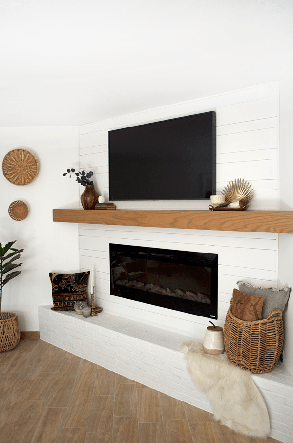 white shiplap on a modern fireplace