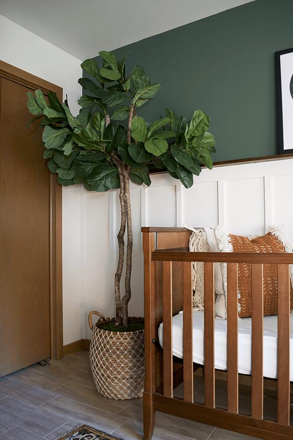 faux fiddle leaf fig in a modern vintage nursery