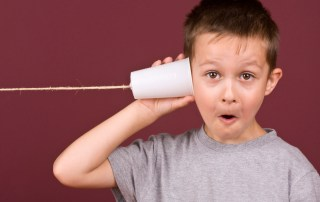 child on phone voice note