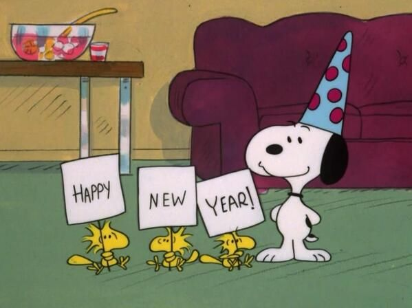 Snoopy and Woodstock with Happy New Year signs