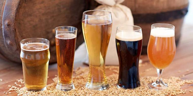 Glasses of different flavored beer