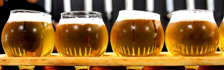 Four glasses of beer with different levels of clarity
