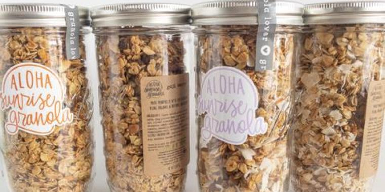 Four glass mason jars filled with granola cereal